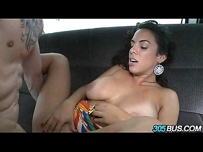 Curly hair babe playing with tits.