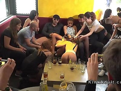 Public slave sucks fucks in crowd