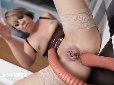 Milf handling a huge anal plug in her ass