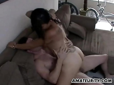 Amateur young couple doing it in the living room with facial