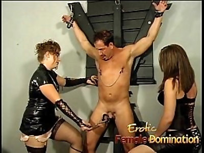 Naughty well hung stallion gets dominated by two horny brunette mistresses