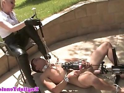 Mistress dominates sub outdoors with machine