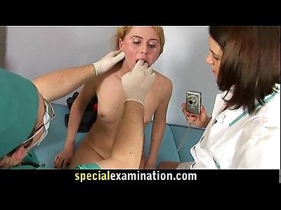 Gynecologist and nurse examine sexy blonde